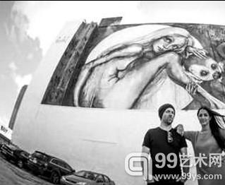 """德国街头艺人墙上绘制""""图画书"""""""